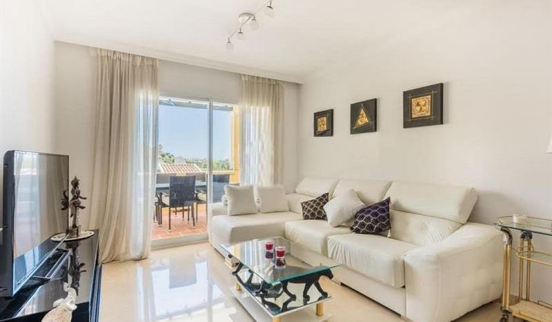Bright apartment with golf views