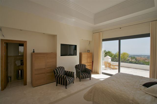 Frontline golf villa with open sea views